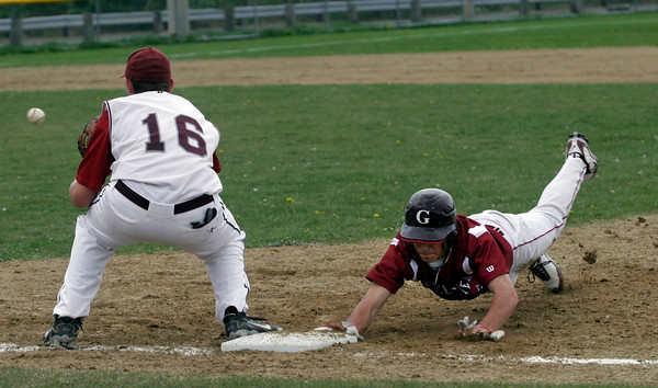 Gloucester: Gloucester second baseman Caulin Rogers dives safely back to first base as Lynn English first baseman Ben Bowden reaches for the throw yesterday. Photo by Kate Glass/Gloucester Daily Times