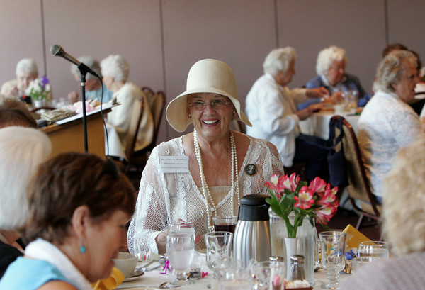 Gloucester: Mary Page, the president of the Gloucester Women's Club laughs with her friends as the Gloucester Women's Club holding its 90th annual get-together at the Gloucester House Thursday afternoon.  Page was attending the lunch in character as Mrs. George W. Woodbury, the clubs first president from 1920 to 1921. Mary Muckenhoupt/Gloucester Daily Times
