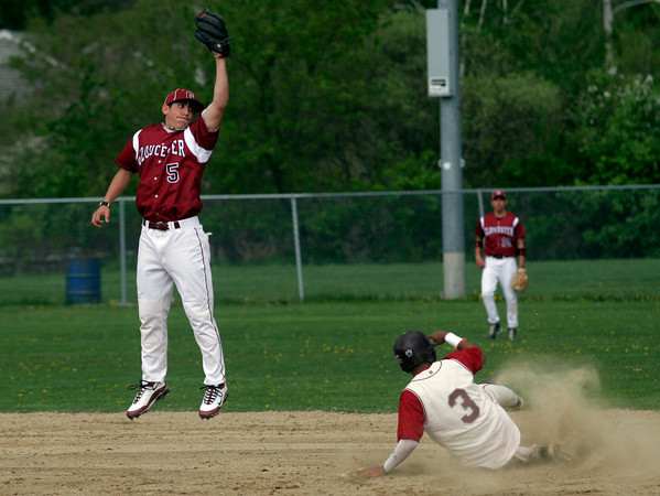 Gloucester: Gloucester's Caulin Rogers leaps for the ball as Lynn English's Junior Santos steals second base yesterday. Photo by Kate Glass/Gloucester Daily Times