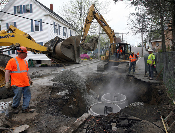 Gloucester: Workers from P. Gioioso & Sons install double catch basins at the bottom of Millett Street as part of the ongoing storm water drainage project in Gloucester. Sewer rates or property tax rates may increase to help cover the cost of the project. Photo by Kate Glass/Gloucester Daily Times