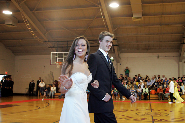 """Rockport: Rockport seniors Daria Whittaker and John Bradford walk the """"red carpet"""" at the Rockport High School promenade held in the Stephen Rowell Gymnasium before heading to prom Friday night.  This year's Rockport High School prom was held at the Hawthorne Hotel in Salem. Mary Muckenhoupt/Gloucester Daily Times"""