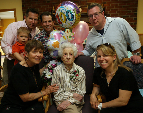 """""""Dot"""" Finn is surrounded by her family (clockwise from bottom left): Liz Ritcey, Will Ritcey, Rob Ritcey, Ian Ritcey, Ben Ritcey, and Regina Ritcey during her 100th birthday party at Den Mar Rehabilitation & Nursing Center in Rockport on Saturday. Dot grew up in Essex and moved to Gloucester after she got married. Photo by Kate Glass/Gloucester Daily Times"""