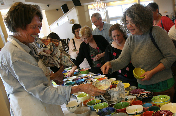 Gloucester: Juni VanDyke, left, helps her friend, Coco Berkman of Gloucester, select a bowl out of hundreds at the Open Door's 10th Annual Empty Bowl Dinner at Cruiseport last night. The event is Open Door's biggest fundraiser. Photo by Kate Glass/Gloucester Daily Times