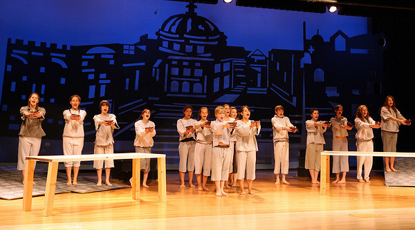 "Manchester: The orphans sing ""Food Glorious Food"" as they rehearse for Manchester Essex Regional High School's production of ""Oliver!"" which will be performed today at 4 and Friday and Saturday at 7 in the High School auditorium. Tickets are $10 for adults and $8 for students and seniors.  Photo by Kate Glass/Gloucester Daily Times"