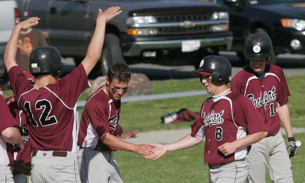 Essex: Rockport's Pat Frithsen is congratulated by his teammates after hitting a home run during their game against Manchester Essex. Photo by Kate Glass/Gloucester Daily Times