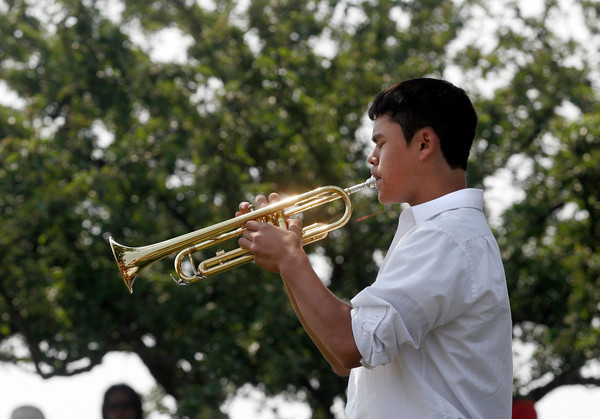 Gloucester: Matthew Catarino plays Taps at the Gloucester Memorial Day ceremony at Kent Circle yesterday morning. Photo by Kate Glass/Gloucester Daily Times