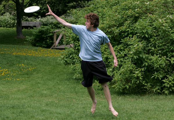 Rockport: Frank Evans of Rockport jumps up to catch a Frisbee thrown to him by his friend Zach Darbeloff while enjoying a sunny Saturday afternoon at Millbrook Meadow. Mary Muckenhoupt/Gloucester Daily Times