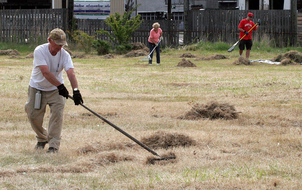 Gloucester: Damon Cummings de-thaches the grass on the I-4, C-2 property in Gloucester on Saturday morning. A group of volunteers helped clean the site after the DPW removed large objects last week. Photo by Kate Glass/Gloucester Daily Times