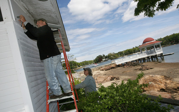 Manchester: Shawn Johnson and John Davis of the Manchester DPW remove window coverings from the bath house at Tuck's Point on Monday afternoon in preparation for the summer season. Photo by Kate Glass/Gloucester Daily Times