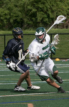 Manchester: Manchester Essex's Jack Bishop cradles the ball around St. Mary's David Betz during the lacrosse game at Coach Ed Field Field Friday afternoon. Manchester Essex defeated St. Mary's 12-5. Mary Muckenhoupt/Gloucester Daily Times