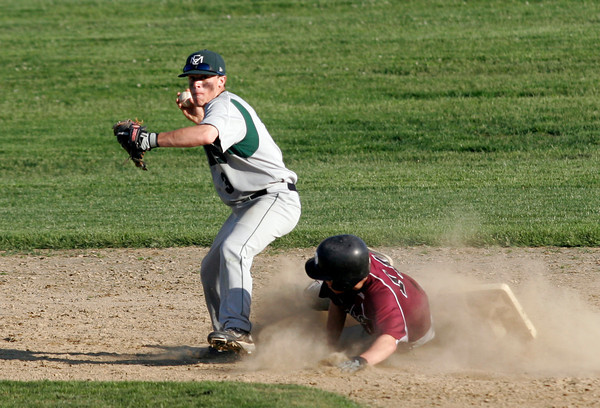 Essex: Manchester Essex's Danny Oliver-Munn looks to turn two as Rockport's Jay Fulmer is out at second base during their game at Memorial Field in Essex yesterday. Photo by Kate Glass/Gloucester Daily Times
