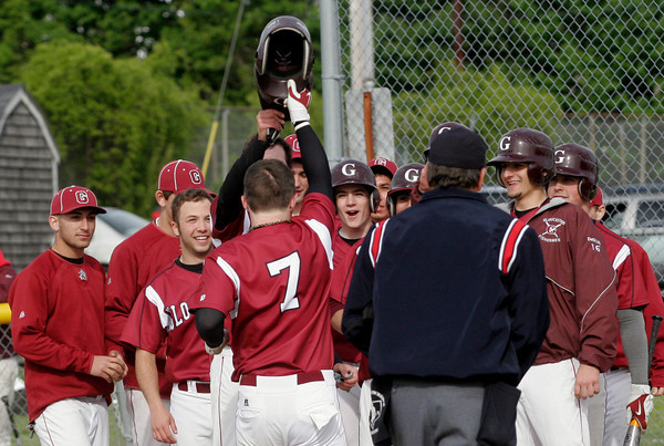 Gloucester: Members of the Gloucester Baseball team greet Conor Ressel at home plate following his grand slam in the second inning of their game against Salem at Nate Ross Field yesterday afternoon. Photo by Kate Glass/Gloucester Daily Times