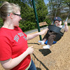 Essex: Amy Dodge pushes her son, Gavin Dodge, 1, on the swings at the Memorial Park playground Thursday afternoon. Photo by Kate Glass/Gloucester Daily Times