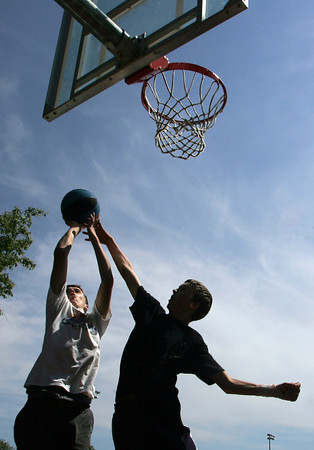 Rockport: Conor Kuykendall, 13, shoots over Sam Knowlton, 13, while playing three on three behind Rockport High School Thursday afternoon.  The boys were outside enjoying the nice weather which is expected to continue into next week with a few clouds moving in Saturday and Sunday.  Mary Muckenhoupt/Gloucester Daily Times