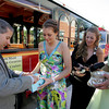 Manchester: Assistant Principal Paul Murphy checks the purse of Jacquie McKay, as a precautionary measure before allowing students on the trolley after a bomb threat was called into the Hellenic Community Center, the location of the Manchester Essex Prom Friday evening. Also pictured is Krista Rajunas and Ashley Grimes. Mary Muckenhoupt/Gloucester Daily Times