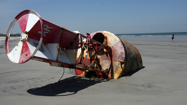 Gloucester: The Annisquam River bell buoy, which washed ashore on Coffin's Beach during a storm in March, has still not been removed from the beach. Photo by Kate Glass/Gloucester Daily Times