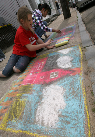 Rockport: Sofie Moulton, 8, and Z. Lily Perry, 11, both of Rockport, draw Motif #1 in chalk for the sidewalk chalk drawing contest during Motif #1 Day in Rockport on Saturday. Photo by Kate Glass/Gloucester Daily Times
