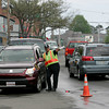 Gloucester: Ipswich police officer Ed Walsh working detail on Rogers Street gives motorists directions before sending them up Porter Street to detour the section of Rogers Street that was being paved Thursday afternoon. Mary Muckenhoupt/Gloucester Daily Times