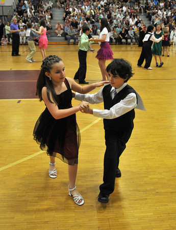 Gloucester: Haley Williams 11, and Devin Quinn 12,dance the swing at the Mad Hot Ball held at the GHS on Sunday afternoon. Desi Smith Photo/Gloucester Daily Times. May 2,2010.