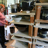 Gloucester: Marty Morgan of Gloucester looks over bowls she just removed from her kiln for the Empty Bowl Dinner, which is at Cruiseport tomorrow from 4 to 8. Morgan glazes many of the bowls for the annual fundraiser for The Open Door. Photo by Kate Glass/Gloucester Daily Times