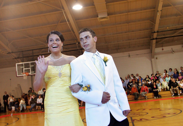 "Rockport: Rockport seniors Lauren McKechnie and Scott Noble walk the ""red carpet"" at the Rockport High School promenade held in the Stephen Rowell Gymnasium before heading to prom Friday night.  This year's Rockport High School prom was held at the Hawthorne Hotel in Salem. Mary Muckenhoupt/Gloucester Daily Times"