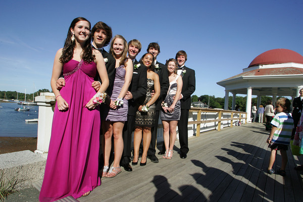 Manchester: From left, Justine Kane, Nick Velonis, Nora Flynn, Scott Cowman, Jasmine Bailey, Brian Kaneb, Emily Malik and Tyler Weihs pose for a picture at Tucks Point before heading to the Manchester Essex prom Friday evening. The Manchester Essex Regional High School prom was held at the Hellenic Community Center in Ipswich. Mary Muckenhoupt/Gloucester Daily Times