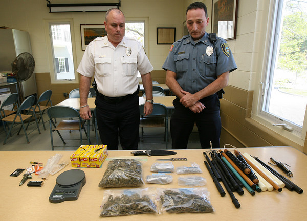 Essex: Essex Police Chief Peter Silva and Officer Rob Gilardi survey the items found in a Pond Street home late Wednesday night while responding to a domestic dispute. Among the items seized are two pounds of marijuana, several pairs of nunchuks, and a double-edged knife. Photo by Kate Glass/Gloucester Daily Times