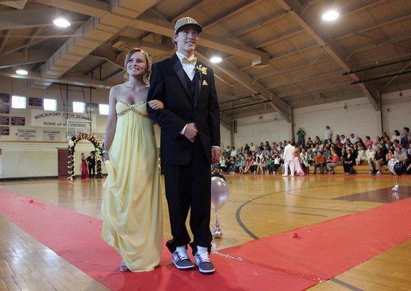 "Rockport: Rockport's Kyle Keating and Alana Williamson walk the ""red carpet"" at the Rockport High School promenade held in the Stephen Rowell Gymnasium before heading to prom Friday night.  This year's Rockport High School prom was held at the Hawthorne Hotel in Salem. Mary Muckenhoupt/Gloucester Daily Times"