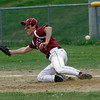 Gloucester: Gloucester first baseman Adam Philpott dives to catch a throw during an attempted double play as they play Lynn English, but throw went wide. Photo by Kate Glass/Gloucester Daily Times
