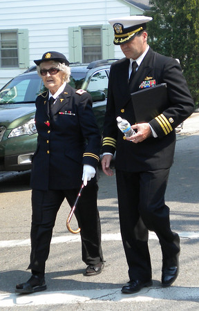 Rockport: U.S. Army Nurse June Sullivan, who turns 90 today, walks alongside her son, Lieutenant Commander Brian Sullivan, during Rockport's Memorial Day Parade yesterday morning. Photo by Gail McCarthy/Gloucester Daily Times