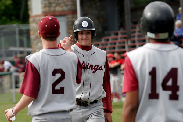 Rockport: Rockport pitcher Derek MacDowell is congratulated by his teammates after hitting the ball deep into center field for a triple and scoring on the next play during their game against Amesbury yesterday. Photo by Kate Glass/Gloucester Daily Times