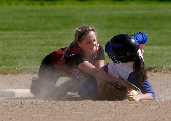 Gloucester: Gloucester second baseman Erin Jermyn reaches for the ball as Danvers' Joanna Zecha slides safely into the base at Burnham Field yesterday afternoon. Photo by Kate Glass/Gloucester Daily Times