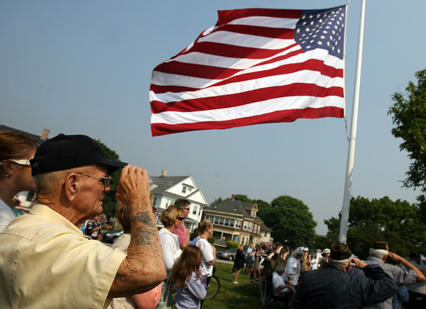 Gloucester: Dexter Murray, who served as a U.S. Navy Seabee during World War II, salutes as the flag is raised at Kent Circle during Gloucester's Memorial Day ceremony yesterday morning. Photo by Kate Glass/Gloucester Daily Times