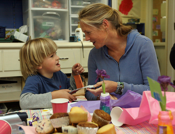 Gloucester: Mac Trotman shows his mom, Abi Trotman, one of the gifts he made for her during Lanesville Preschool Center's Mother's Day Breakfast yesterday morning. The students also performed songs for their mothers. Photo by Kate Glass/Gloucester Daily Times