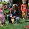Rockport: Skye Ciolino, 2, sticks her tongue out after getting a lobster into the basket at the lobster toss while her mom, Jen Ciolino, and brother, Cole Ciolino, 3, look on during Motif #1 Day in Rockport on Saturday. Photo by Kate Glass/Gloucester Daily Times