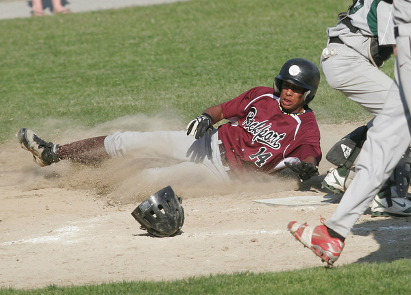 Essex: Rockport's Andreas Contreras slides safelly into home plate during their 13-6 win over Manchester Essex at Memorial Field yesterday. The win gets Rockport into the playoffs. Photo by Kate Glass/Gloucester Daily Times