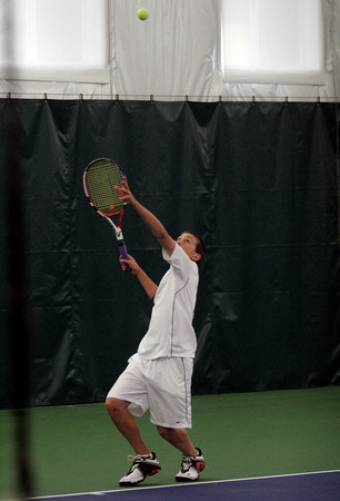 Manchester: Manchester Essex's Myles Wood tosses to serve as the Hornets compete against Hamilton-Wenham at the MAC yesterday. Photo by Kate Glass/Gloucester Daily Times