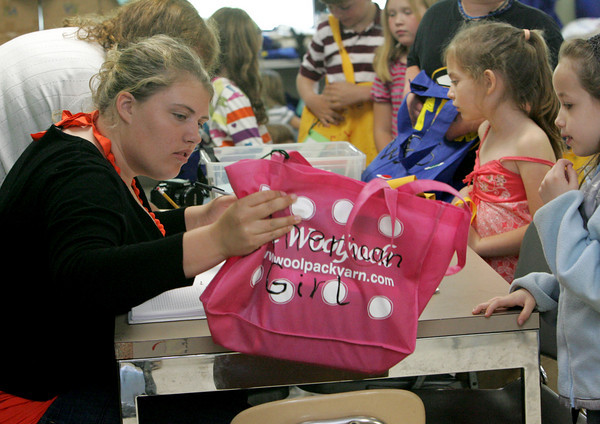 Rockport: Rockport High School junior Emily Collins checks out book bags in Julie Raftelis' second grade class room Thursday afternoon. Collins is working on her Gold Award for Girl Scouts and has put together more than 100 book bags for students to take home. Mary Muckenhoupt/Gloucester Daily Times