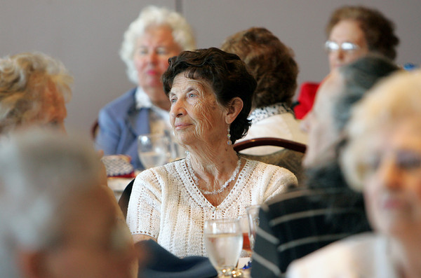 Gloucester: Dolores Talbot listens to Helen Johnson read a poem before lunch as the Gloucester Women's Club holdis its 90th annual get-together at the Gloucester House Thursday afternoon. Talbot, age 85, says she has been a member of the Gloucester Womens Club for at least 30 years. Mary Muckenhoupt/Gloucester Daily Times