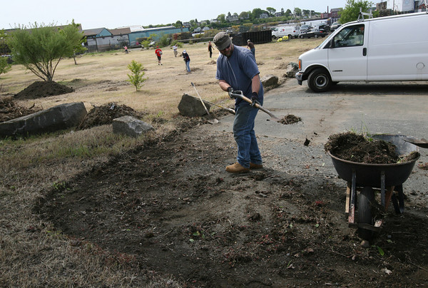 Gloucester: Russell Hobbs helps neaten up the parking area for the I-4, C-2 property in Gloucester on Saturday morning. A group of volunteers helped clean the site after the DPW removed large objects last week. Photo by Kate Glass/Gloucester Daily Times
