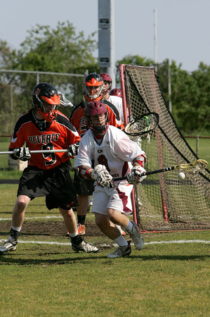 Gloucester: Gloucester's Geoffrey Kennedy looses possession of the ball in front of Beverly's Ryan Gilligan during the lacrosse game at Newell Stadium Thursday afternoon. Mary Muckenhoupt/Gloucester Daily Times