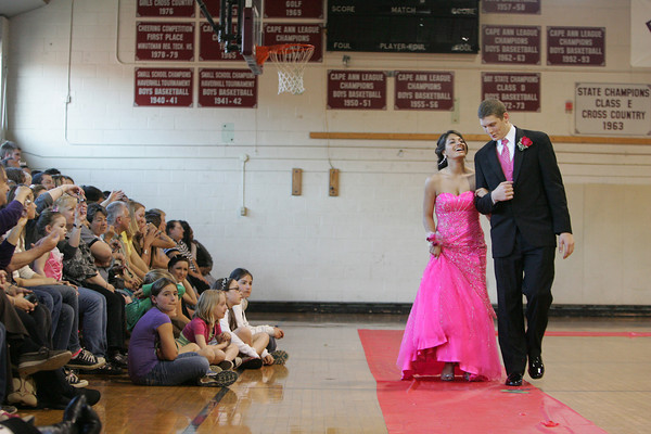 "Rockport: Rockport senior Josh Altman and his date Erica Aiello of Gloucester walk the ""red carpet"" at the Rockport High School promenade held in the Stephen Rowell Gymnasium before heading to prom Friday night.  This year's Rockport High School prom was held at the Hawthorne Hotel in Salem. Mary Muckenhoupt/Gloucester Daily Times"