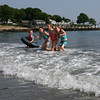 Gloucester: Charlie Swanson, 4, Courtney Dellicker, 7, Paige Swanson, 8, Caroline Dellicker, 7, and Sam Dellicker, 10, play in the waves at Grey Beach in Magnolia on Wednesday. The kids all said the water did not feel cold. Photo by Kate Glass/Gloucester Daily Times