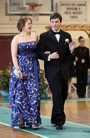 Rockport: Class President Emily Ohrtman laughs as her date, Vice President Seth Perkins, dances around the gym during the Rockport High School Promenade last night where the seniors showed off their outfits for family and friends before heading to prom. The prom was held at Endicott College's Tuppor Manor. Photo by Kate Glass/Gloucester Daily Times