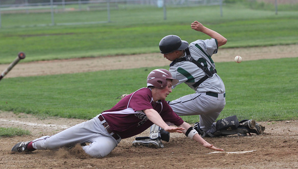 Essex: Rockport's Jason Hendy slides safely into home plate as Mancheter Essex's Dom Cirone misses the tag during their game at Memorial Field yesterday. Photo by Kate Glass/Gloucester Daily Times