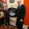 Gloucester: David Mering, owner of Nor'east Cleaners, and Amanda Feener stand in front of the machine he purchased that uses an organic compound, Solvon K4, in their dry cleaning process. Photo by Kate Glass/Gloucester Daily Times