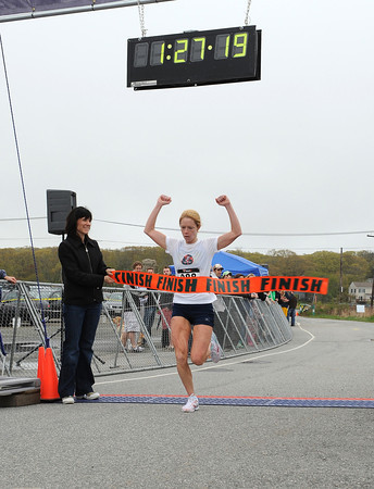 Gloucester: Rockport's Lacy Alves crosses the finish in the Twin Lights Half Marathon with a winning time of 1:27:19 Sunday morning. Lacey said she did better than she thought on her run by 3 minutes Desi Smith/Gloucester Daily Times.