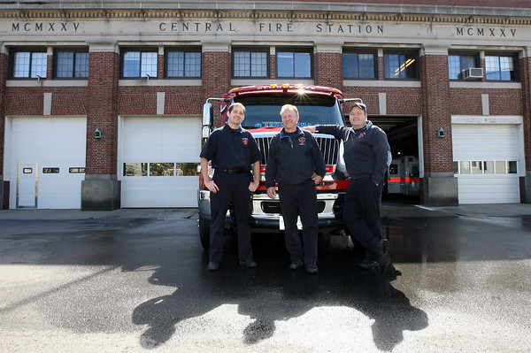 Gloucester: Adam deBrigard, Tony Trupiano, and Jon Sanger of the Gloucester Fire Department stand in front of Rescue 1 at Central Station. The Fire Department has already lost two paramedics due to budget cuts and is expected to lose at least one more in the next fiscal year. Photo by Kate Glass/Gloucester Daily Times