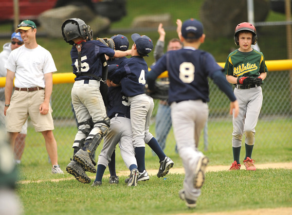 Gloucester: The Twins celebrate their win against the Athltic's Saturday afternoon at Boudreau Field. The Twins made a come back in the 7th inning beating the Athletic's 9-7. Desi Smith Gloucester Daily Times.