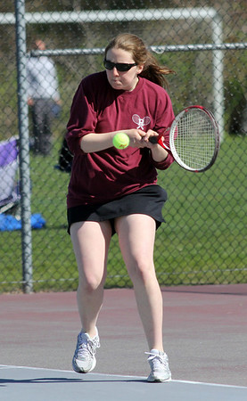 Rockport's Elizabeth Saville hits a backhand during their match against Hamilton-Wenham yesterday. Photo by Kate Glass/Gloucester Daily Times